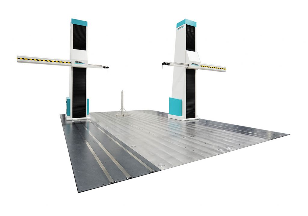 Coordinated Measuring Machine with two pillars and horizonal arms with flat metal plate bottom on white background