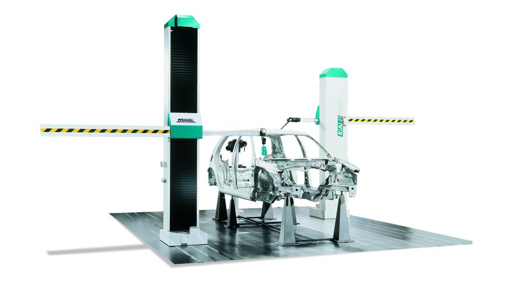 RA Plus WENZEL CMM with two large pillars holding horizontal arms with a car frame on the flat, black base.