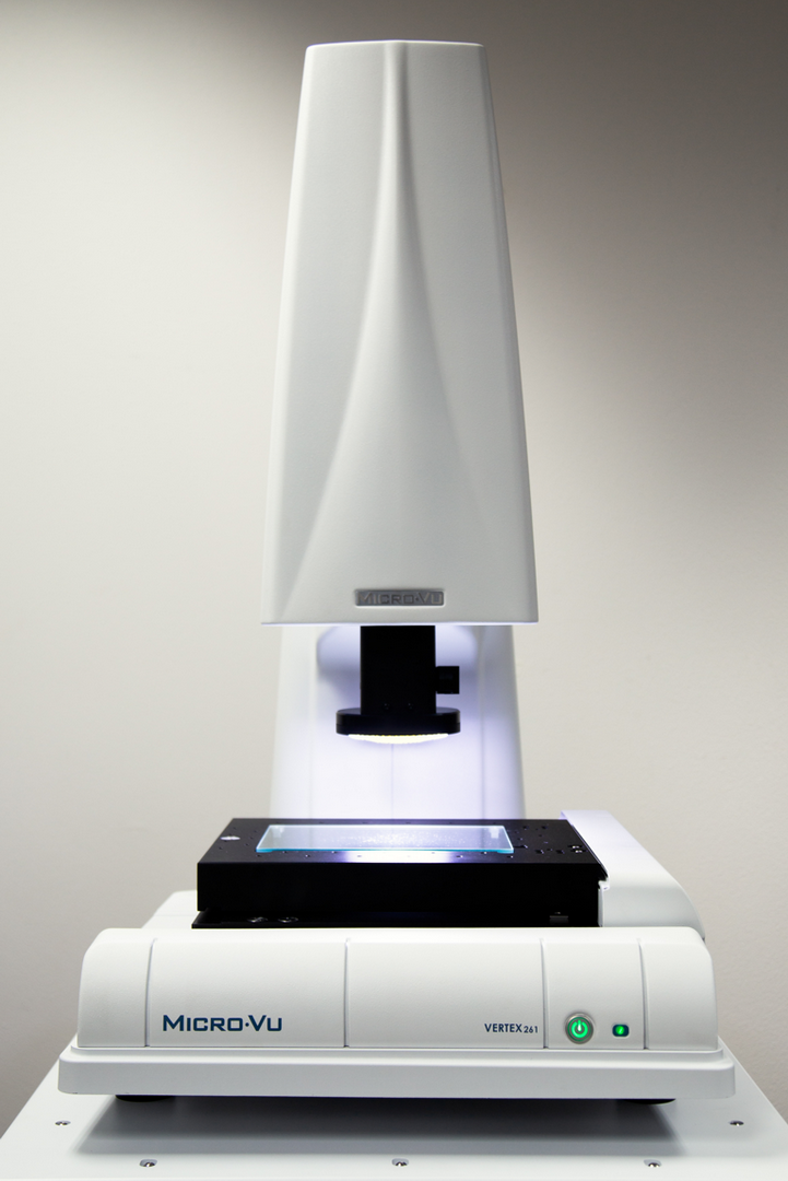 Full view of white Vertex Micro-Vu Product with microscope objective over the black viewing stage.