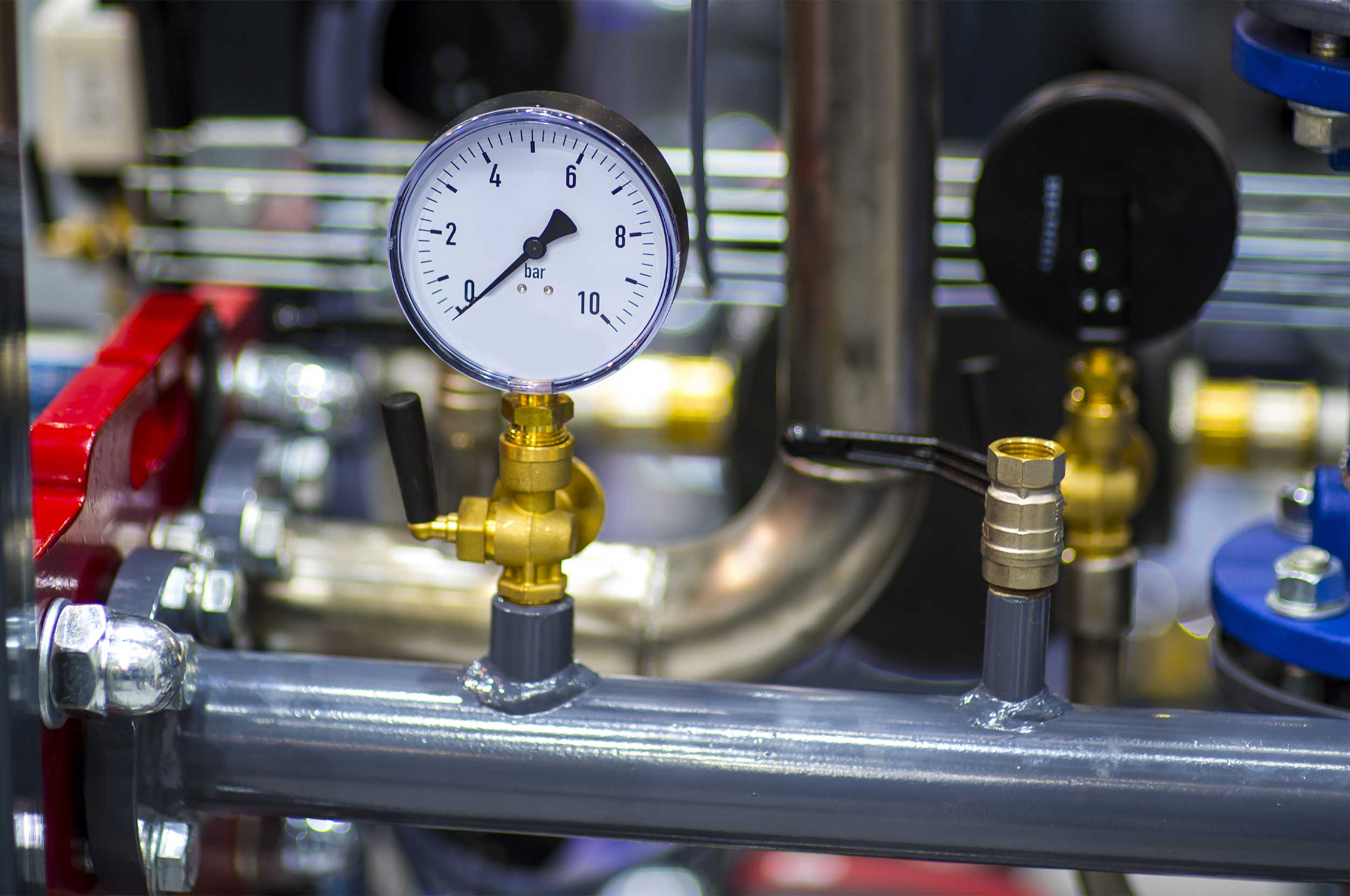 Pressure Gauge PSI Meter in pipe and valves of a water system